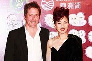 Hugh Grant and Tinglan Hong