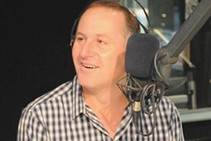 John Key on that 3 way handshake, Chang's xmas present & has a sing