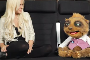 Lindsay Lohan laughs at legal worries during puppet sketch
