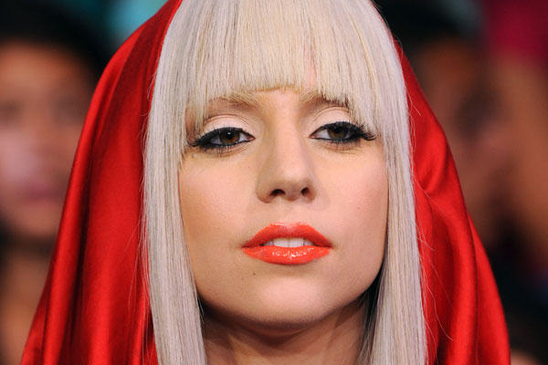 Gaga hands her prize money to charity.