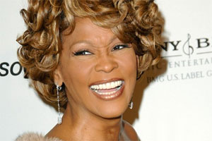 Where can you hear Whitney's last two songs she recorded