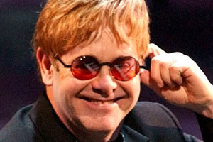 Which hot actor was gyrating against Elton John on Tuesday?