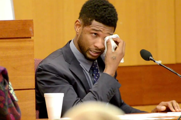 Usher cries in court