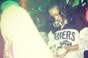 Rihanna tweets racy photos from strip club