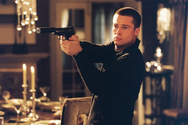 Brad Pitt loves his gun