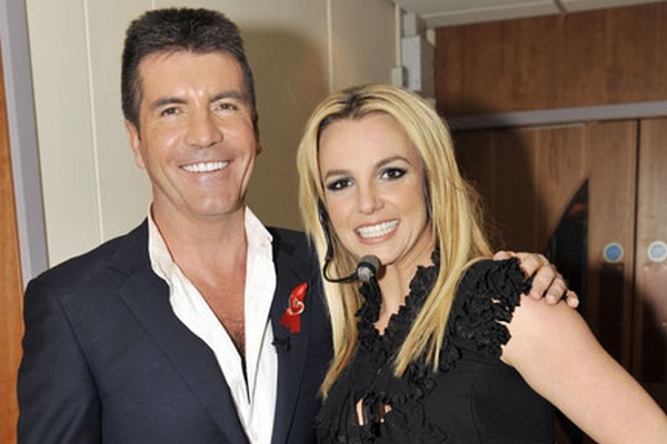 Simon Cowell offers to pay for Britney's wedding if she does what?