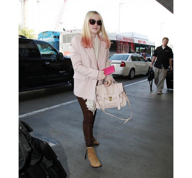Dakota Fanning likes her Acne Boots in brown!