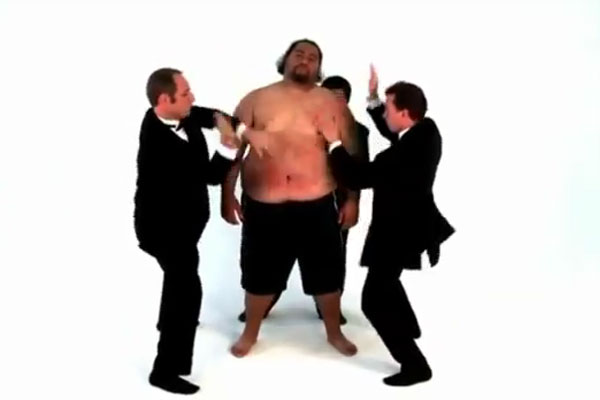 Playing the drums on a fat guy