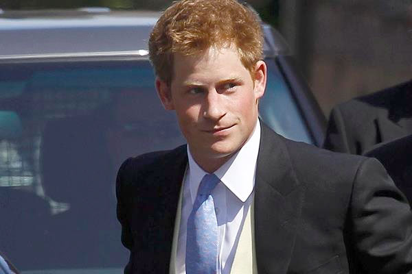 Prince Harry parties his face off again