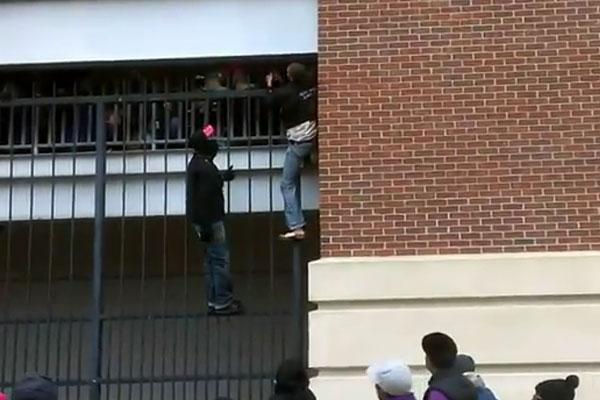 Crazy football fan climbs fence to get inside stadium