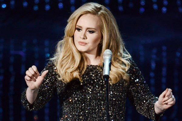 Adele's '21' named the biggest selling album in the world for a second year