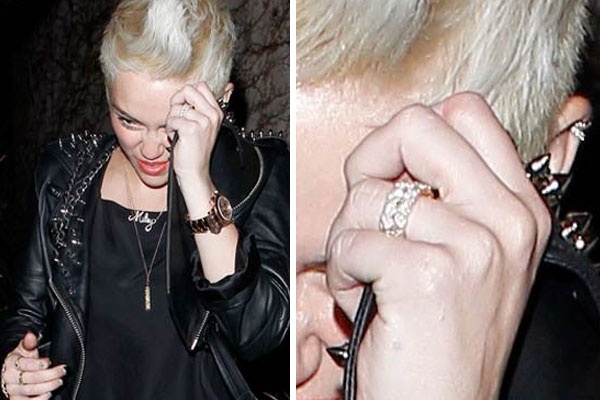 Miley seen without her engagement ring