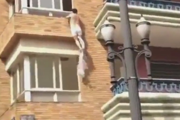Husband catches cheating wife as her boyfriend escapes from window