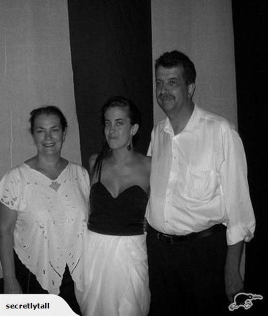 I am wearing a $200 Dollhouse dress in the photo with my parents at my 21st. I am proud to say I did not spill anything on it that night.