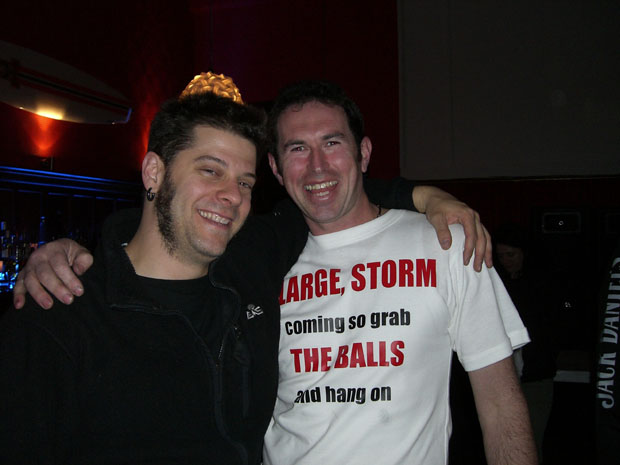 """This is me with Davey Loprinzi from the band in my own T-shirt design when """"Storm Large and the Balls"""" hit Chch to play The Civic years ago.2007 i think.(Storm from Rock Star Supernova)<br />This T-shirt is memorable because i had the night of my life in it.Had a mate bail from going to the gig so i went alone,met 2 random people who i'm still good friends with today.I saw """"The Valves"""" play and still stay in touch with them.""""Slipping Tongue"""" opened and i'm in contact with some of them and discovered Jennie Skulander who i absolutely love her voice and follow in """"devilskin""""...BUT not only that,Storm saw my t-shirt from the stage and i got to meet her and the whole band after and they all signed it.The 2 randoms i met at the start,well the 3 of us took out the drummer from """"Slipping Tongue"""" for a night on the turps.It was an absolutely momentous night \m/"""