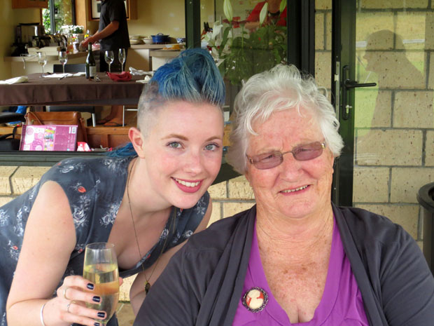 In this photo, I am wearing a dress that used to belong to my Nanna - she made it herself and I always feel close to her when I wear it. On this particular occasion, we were together on Boxing Day as I did 'Shave for a Cure' to raise money for CanTeen NZ - you can see in the photo that half of my blue hair had been shaved at that point and my family was enjoying making all sorts of crazy hairstyles :) it was a wonderful day and my dress always brings back special memories.