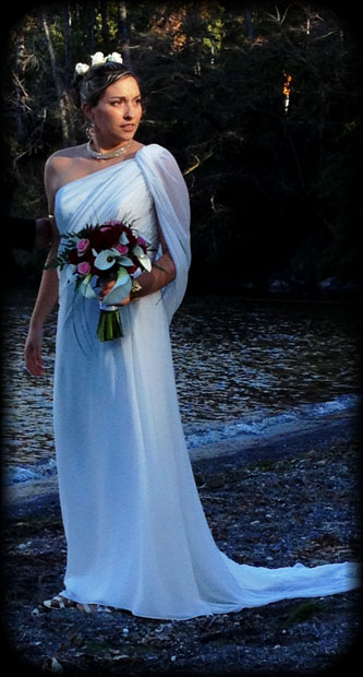 """I am wearing my goddess Wedding dress from Venus Gowns the Pallas Athena 2012-2013 collection. I spent a year look for the perfect goddess dress with the help of my now husband for our big special day. On our wedding day our nephew 2 yrs old said to his dad when I walked in the room """"daddy there is a princess"""". and I certainly did feel like a princess that day. We were married on the 17th of august and even though I wont wear my dress again I will keep it and treasure it for ever. I wish i could wear it every day because to me it is the most beautiful dress ever. :) x"""