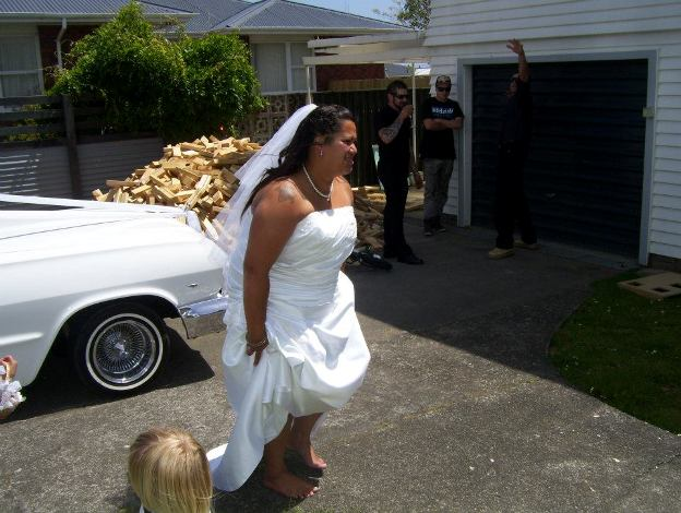 this is my wedding dress on my wedding day, that is me scared because i was holding my dress up so you couldnt see the huge unfortunate rip in it that happend 2 minutes before that picture was taken. This picture reminds me of all the chaotic moments i had on that day, but me and my family managed to pull it together work as a team and help make my day right for me. So i thank them for helping me not turn into a dragon and accept that everything was ok. Its been 2 years now we havnt been on a honey moon still paying off the wedding we have 3 beautiful girls so a win for a 2 thousand dollar clothes woukld be a miracle in my life right now. I never get to go clothes shopping a few tops and tights a month which some of my tights a pretty worn out, so here i am looking for competions to win :)<br />