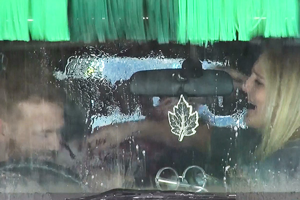 Carl and Sophie swap clothes in a car wash!
