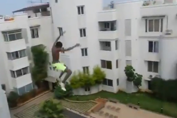 Crazy kid jumps off a 5 story building because YOLO