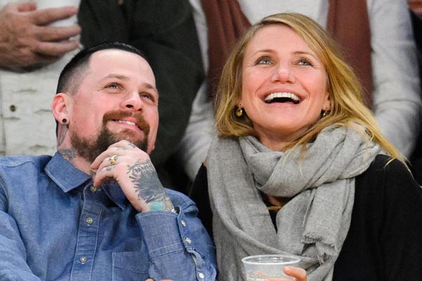 Cameron Diaz and Benji Madden get caught on the Kiss Cam