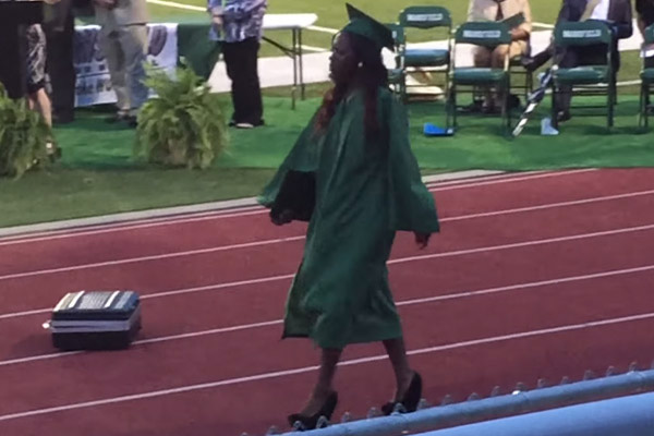 Girl wears platform shoes to graduation and falls hard