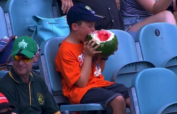 This boy eating a watermelon in the weirdest way is going viral