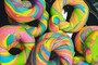 Rainbow bagels are a thing and we want them inside of us right now