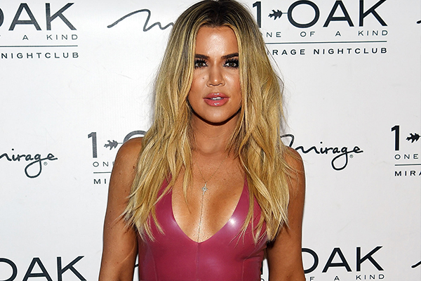 Khloé Kardashian was just spotted GRINDING on this NFL star