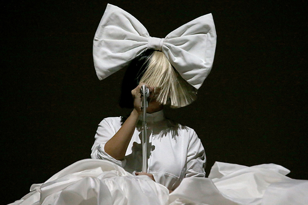 PHOTOS: Sia's wig blew off at a concert and totally REVEALED her face!