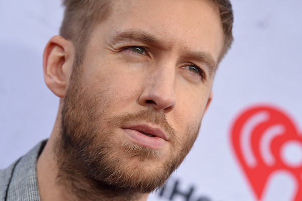 Calvin Harris was snapped getting COSY with new mystery girl!
