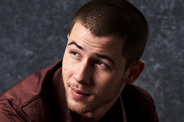 This MAJORLY famous celebrity told Nick Jonas to DUMP his girlfriend!