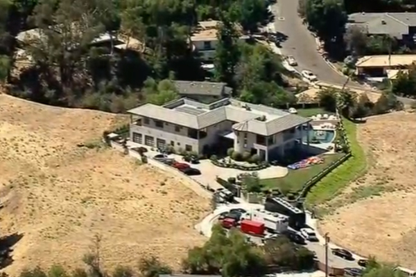 Police are waiting for Chris Brown to SURRENDER outside his home