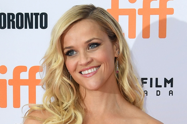 Reese Witherspoon's daughter just walked her first red carpet... lowkey looks like an exact clone